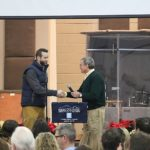 Jay and Chad Vincent shake hands during induction as President of HCAR.