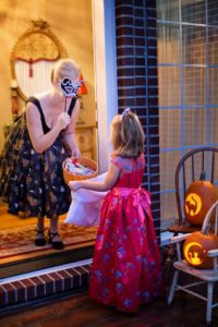 Little Girl in Costume Trick or Treats for Halloween