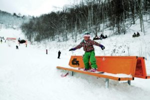 Little girl grinds a bench at Appalachian Ski Mountain